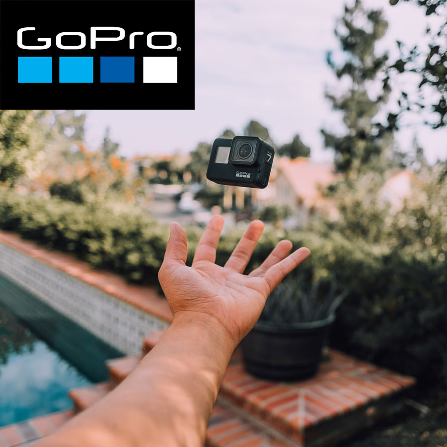 A GoPro Hero 7 floating above a hand with GoPro logo