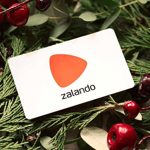 A Zalando gift card for a christmas tree placed on festive decoration