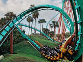 A roller coaster going full speed with many people getting their adrenaline experience